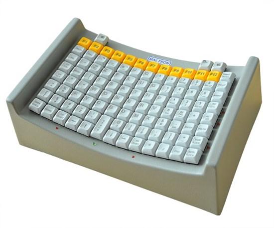 Снимка на  Maltron - klawiatura specjalistyczna umożliwiająca pisanie jednym palcem lub wskaźnikiem trzymanym w ustach